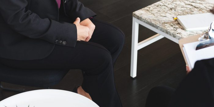 business-woman-sits-for-job-interview